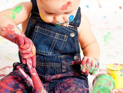Child Playing with Paint Brush