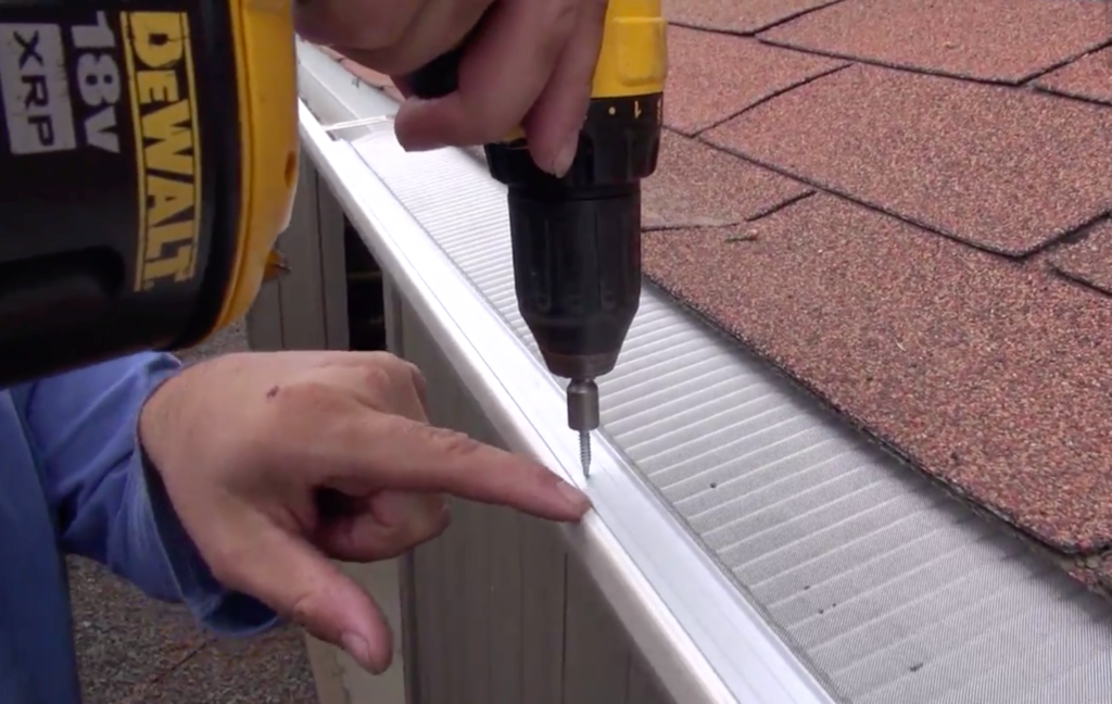 Micromesh gutter guard being installed