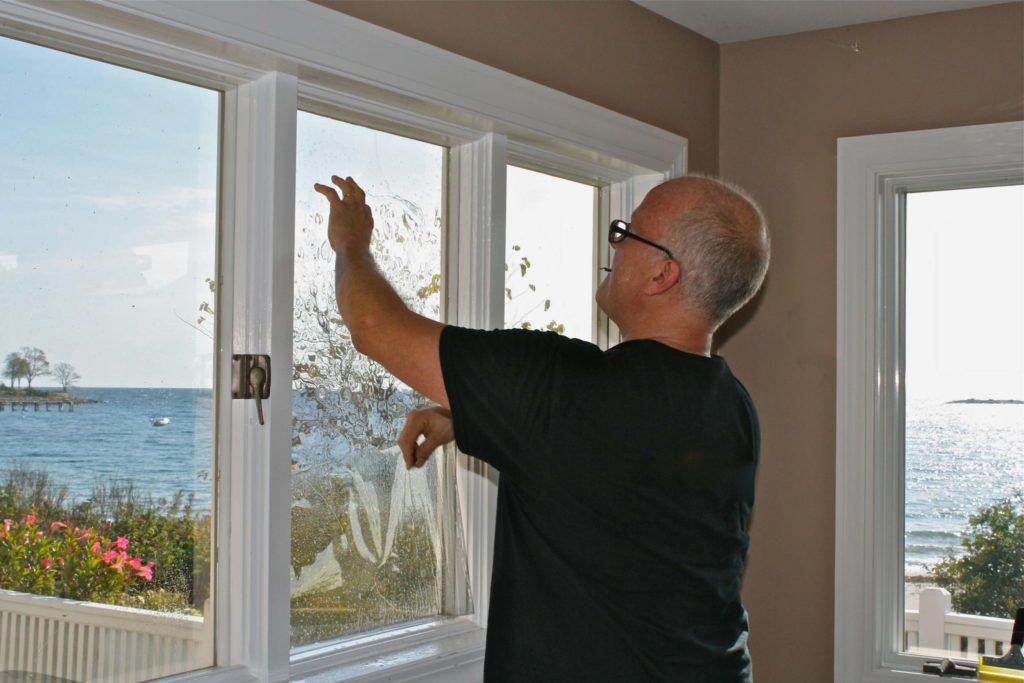 Contractor installing window