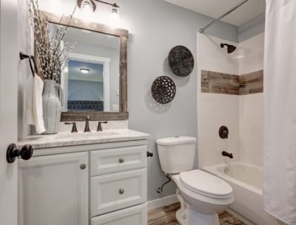 Lovely white bathroom design with reclaimed wood touches