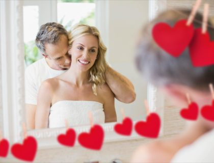 Romantic couple embracing in front of mirror
