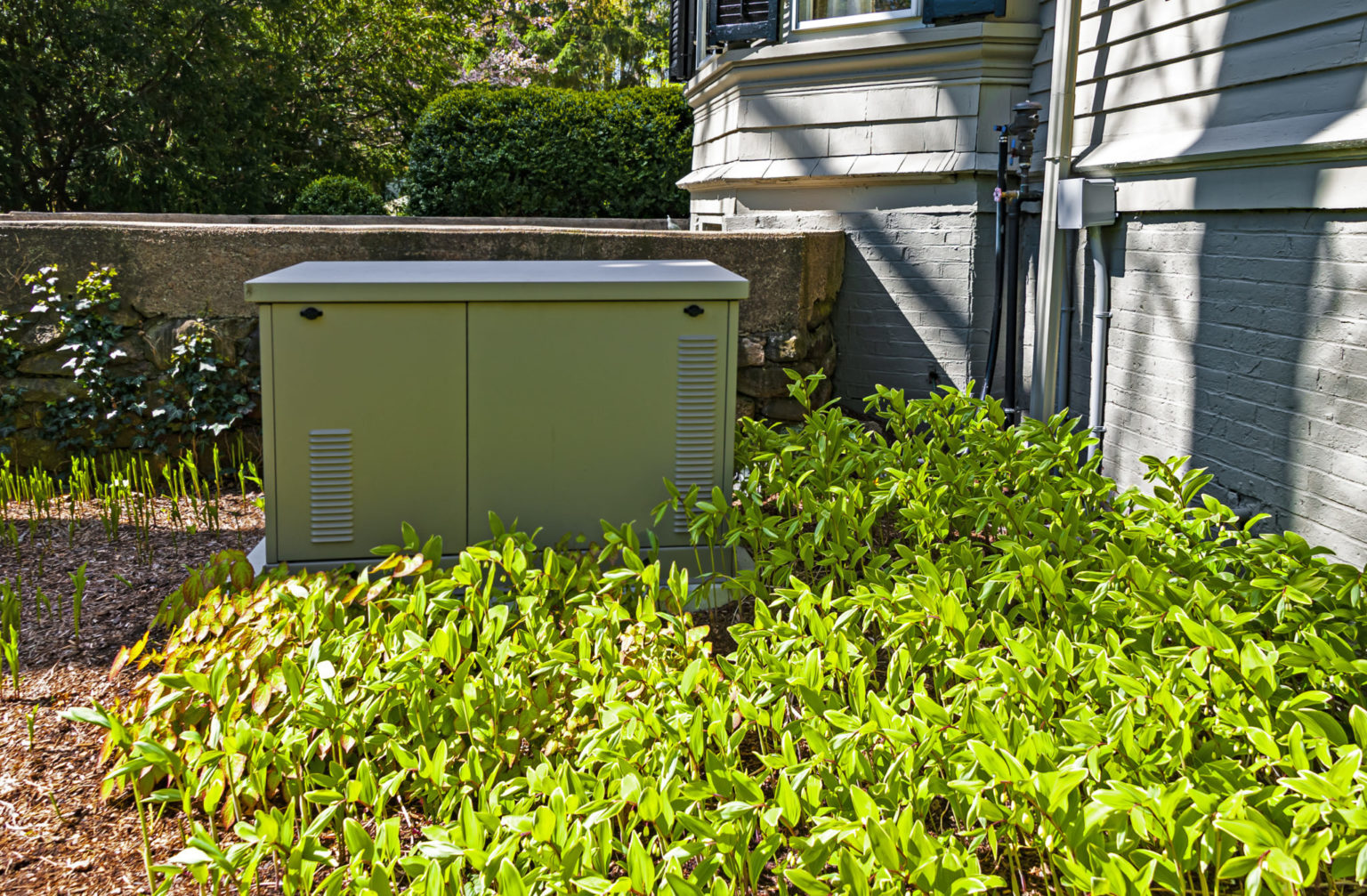 Residential backup generator outside a house