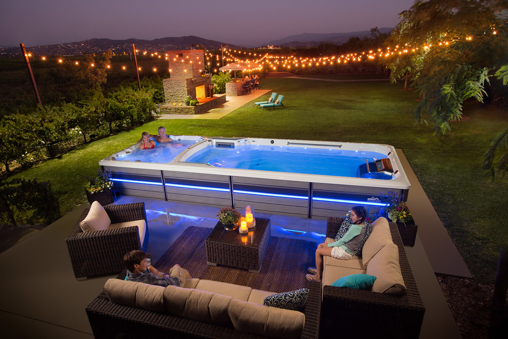 Endless spool in a backyard with a spa pool and lap pool