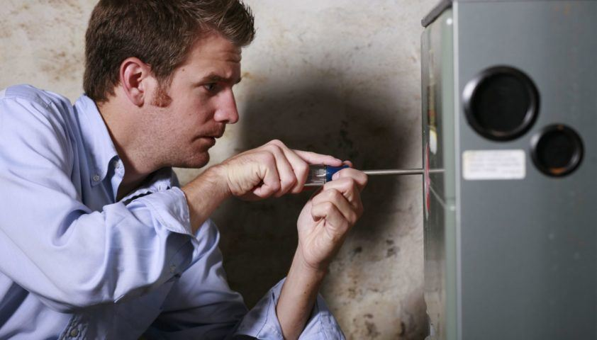 electrician working on furnace