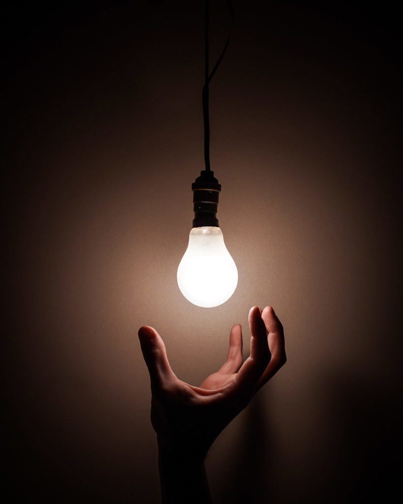 Lightbulb with a hand