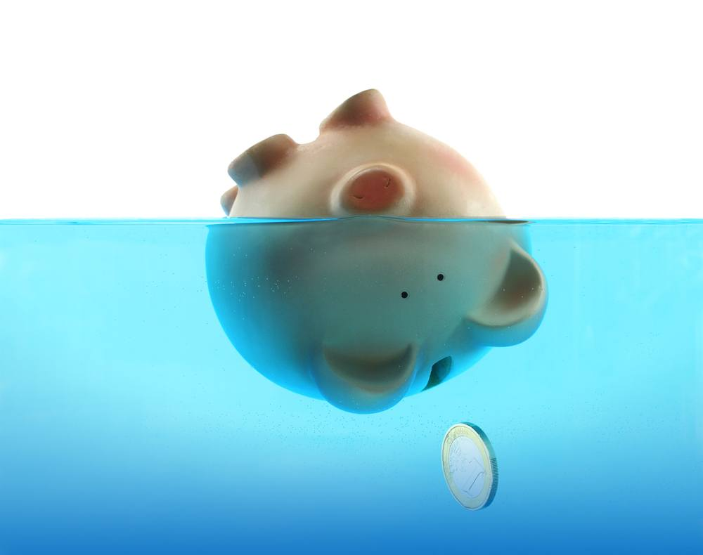 page_05_piggy_bank_in_water_shutterstock_117536578