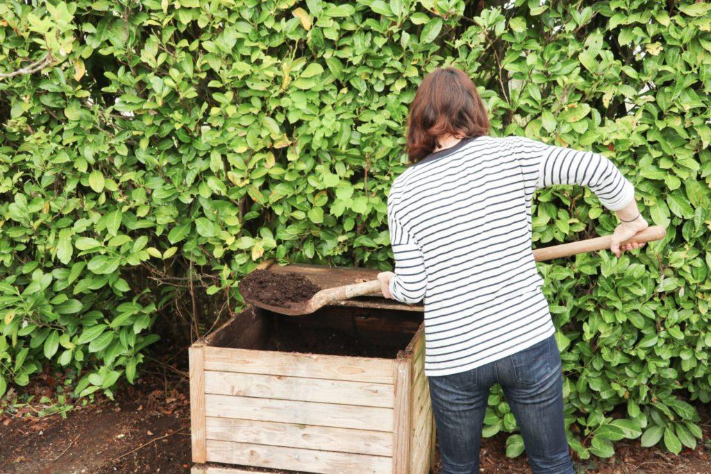 Woman creating compost for a garden