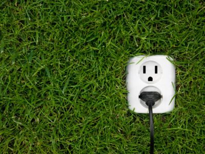 Electric outlet surrounded by green grass