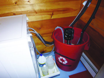 Sump pump in bucket for washer