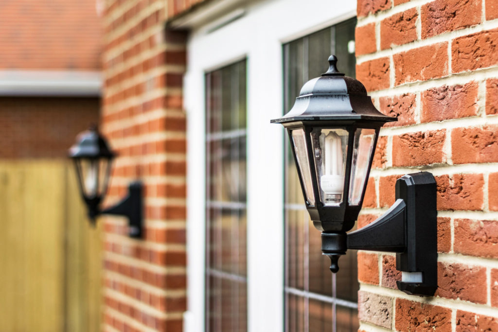 Exterior light near front door with a CFL light bulb