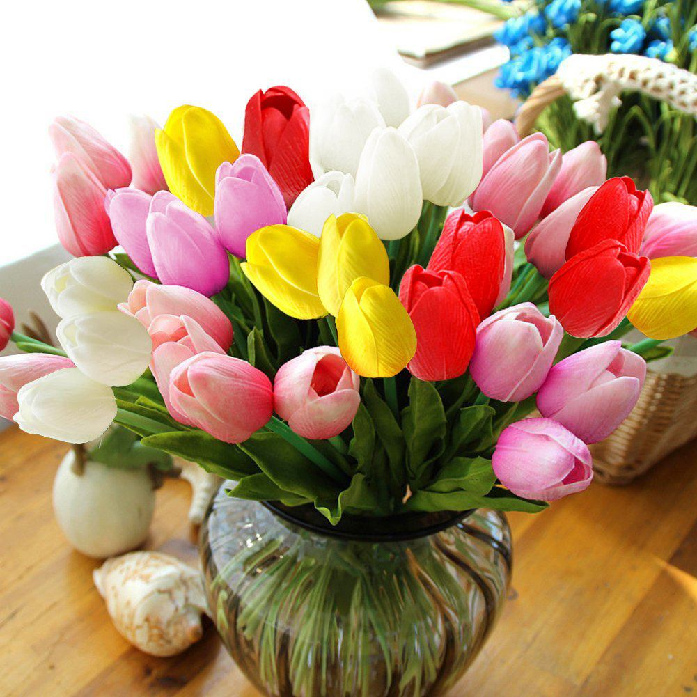 Artificial tulips in a vase on a table