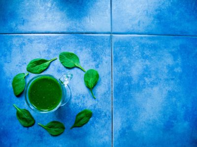 Ceramic tile counter with a green drink