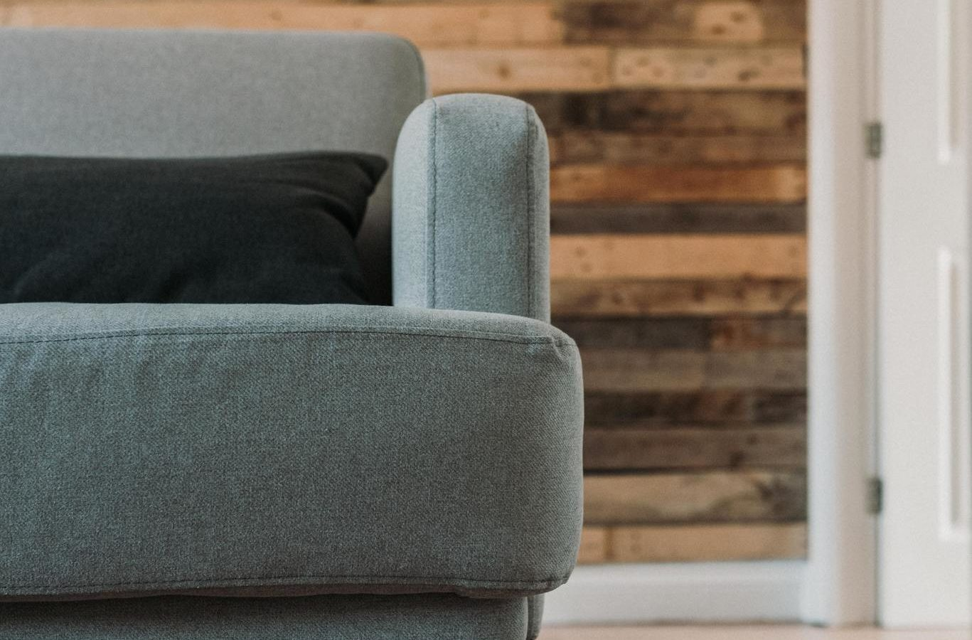 Couch on a Wood Floor with Paneling