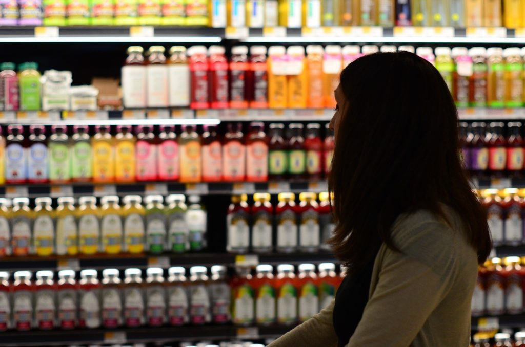 Woman shopping for food in grocery store
