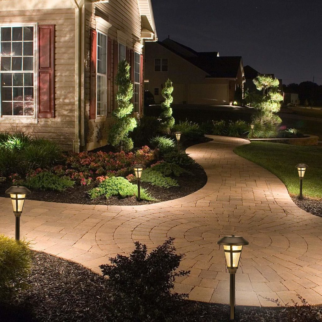 Solar lights on a brick walkway