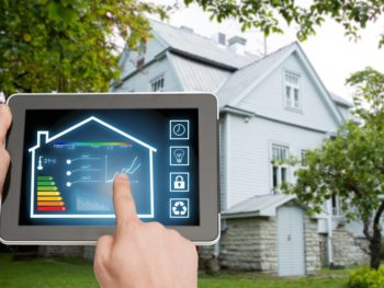 Home energy auditor working with a tablet