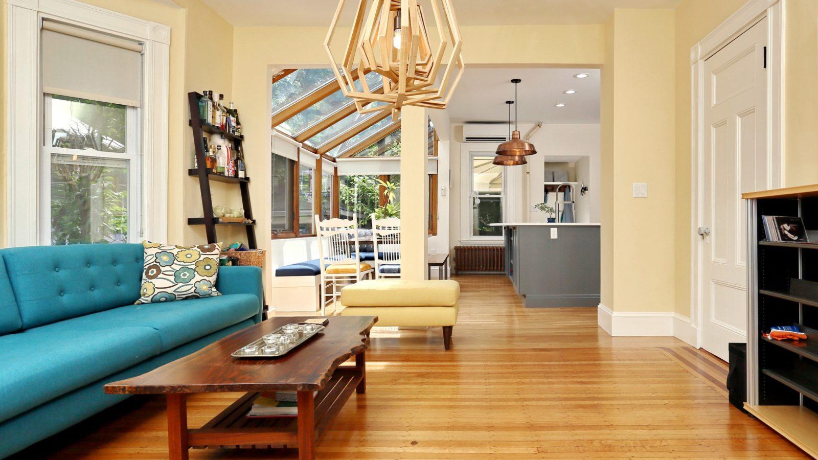Den with hardwood floor