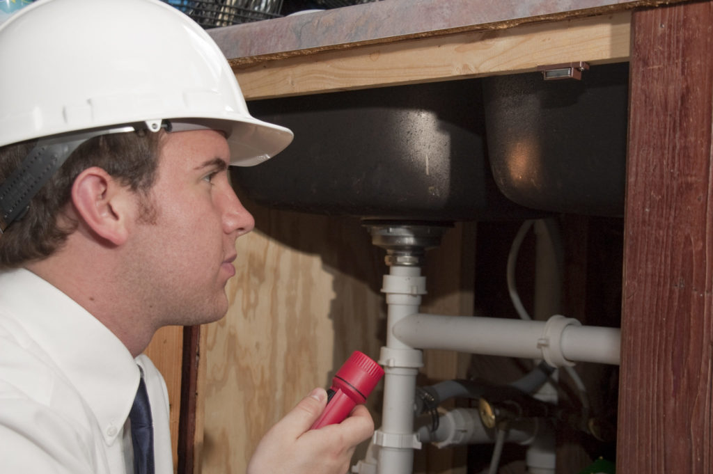 Home inspector looking at a home's structure