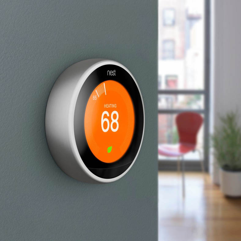 Nest thermostat on grey wall