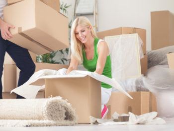 Man and woman packing boxes to move