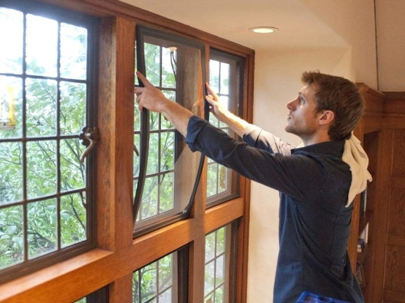 Man installing Indow Window insert