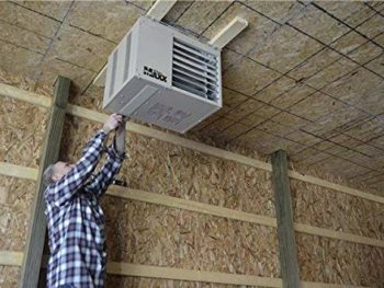 Man installing garage heater