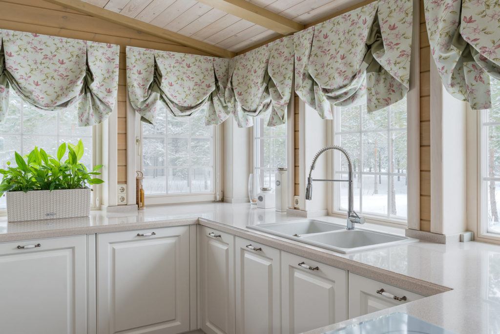 White kitchen windows with swag curtains are an easy add on to your kitchen remodeling project.