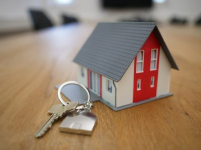 MODEL HOME ON TABLE WITH LOCK AND KEY