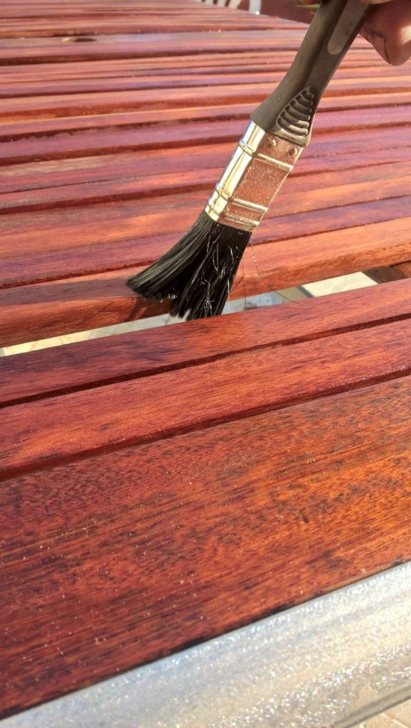 Brush applying wood stain