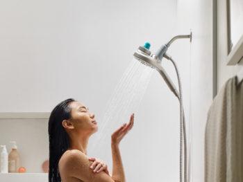 Woman taking aromatherapy shower