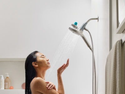 Woman taking aromatherapy shower