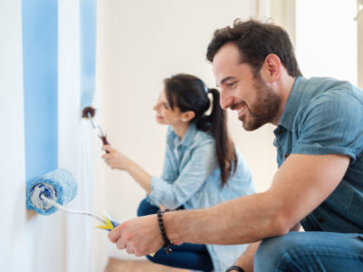 Renovation diy paint couple in new home painting wall together