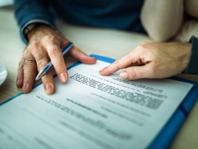 Close up of signing a mortgage contract