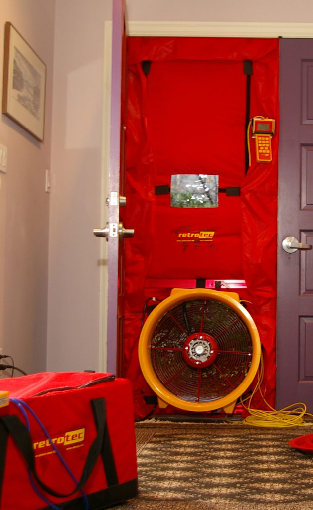 Blower door test in a residential home