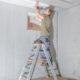 Man installing basement ceiling.