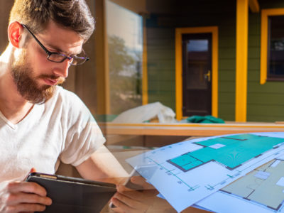 Man reviews plans for a new home build