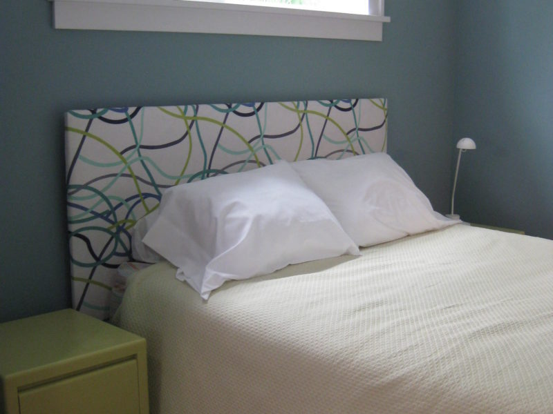 Upolstered headboard in bedroom