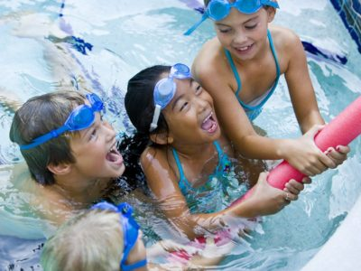 3 children playing in swimming pool