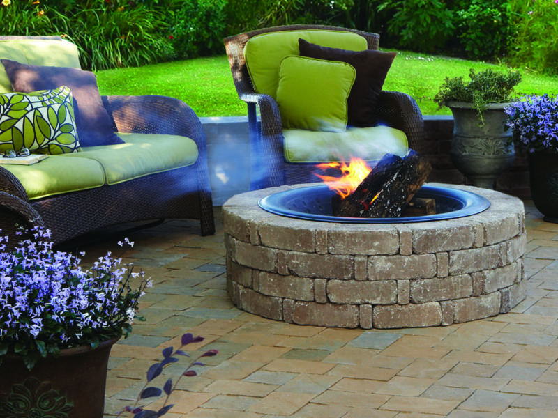 Brick fire pit in a paver patio