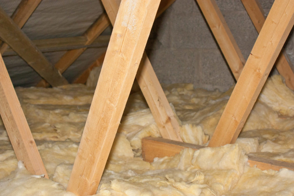 Attic truss and fiberglass insulation.