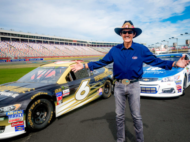 Richard Petty in front of NASCAR Race cars