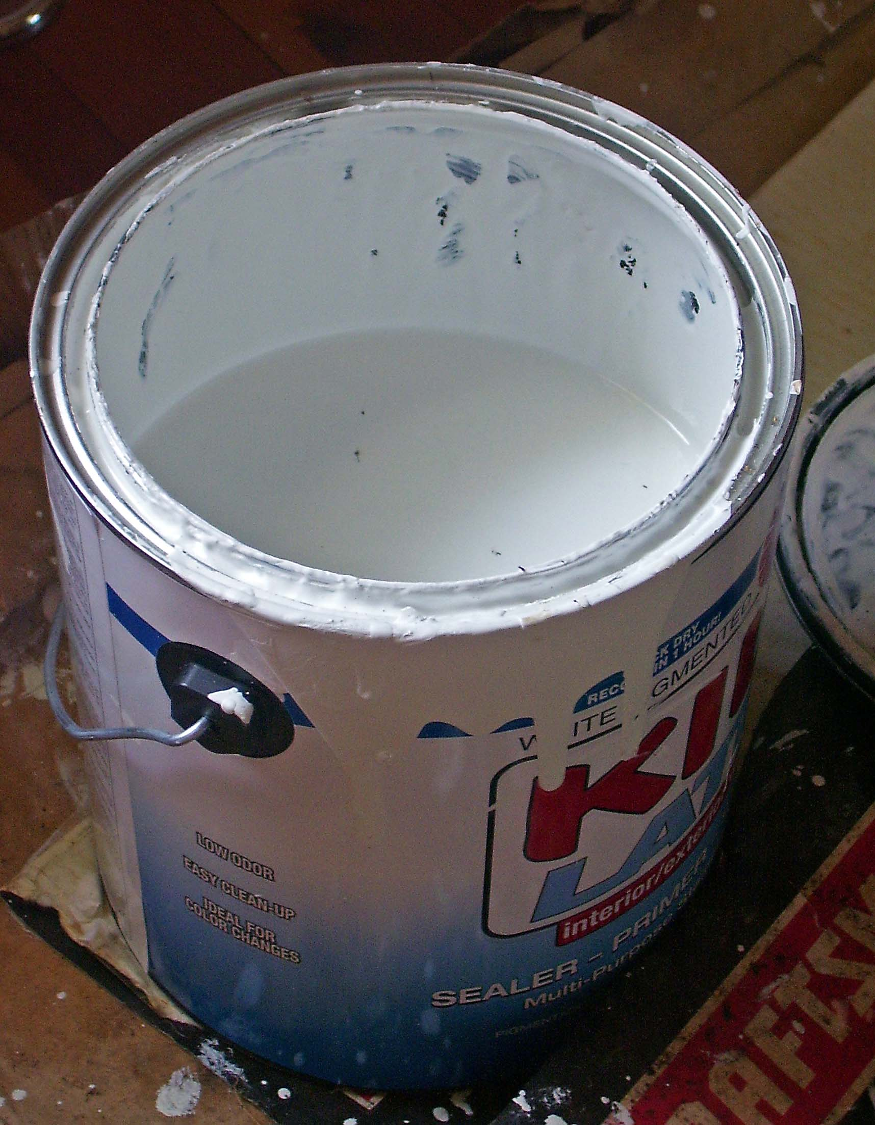 Half empty can of white paint