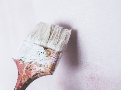 Paint brush painting a wall