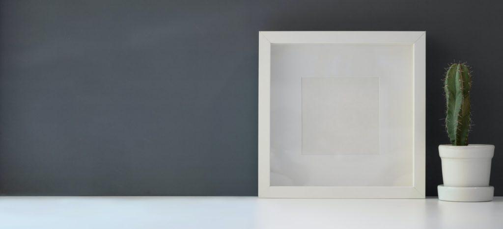 Dark wall over a white desk