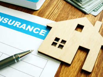 House insurance form for homeowners and model of home.