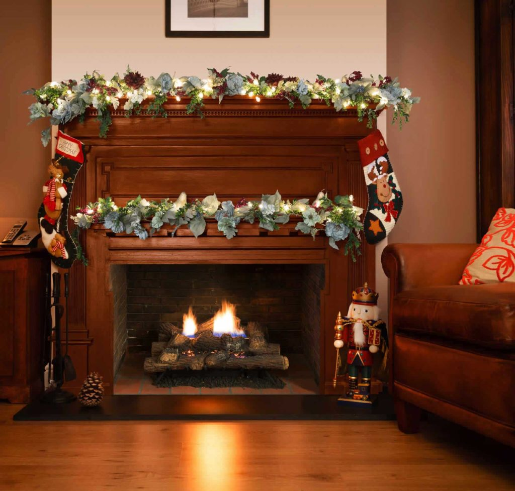 Holiday decorations on a wood mantle