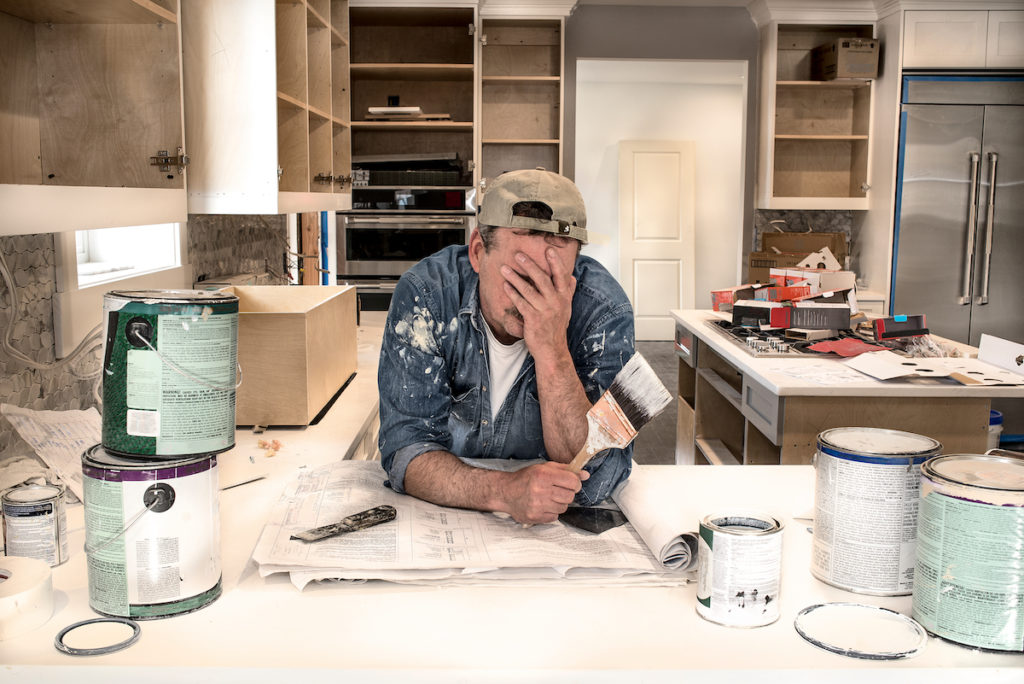 Man frustrated by a home fixup project