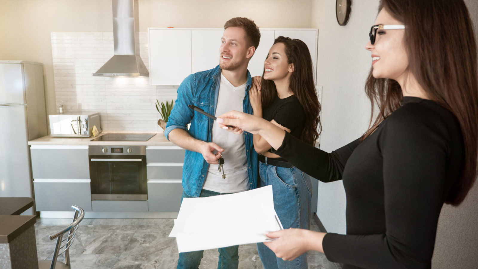Realtor showing a home to a couple