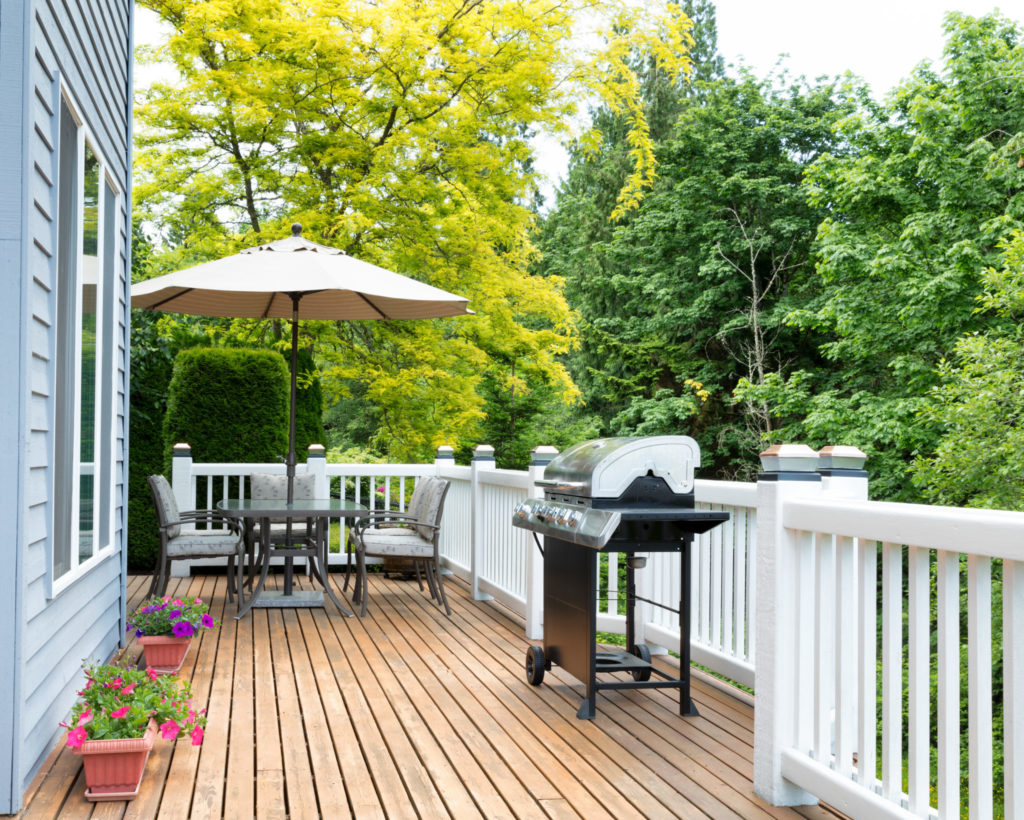 Wood deck with a grill and table