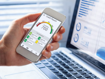 Credit Report with Score rating app on smartphone screen showing credit score